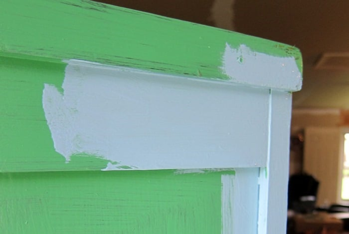 layering blue paint over green paint