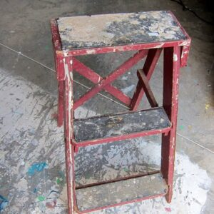 old red step ladder found at the junk shop