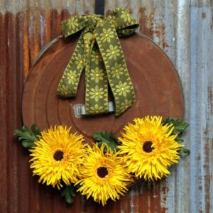 rusty trash can lid sunflower wreath thrift store decor project