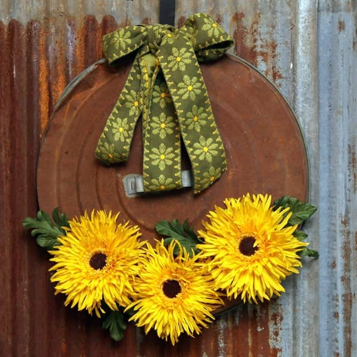 rusty garbage can lid sunflower wreath