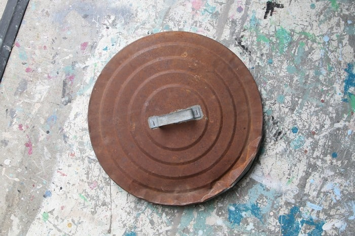 rusty garbage can lid