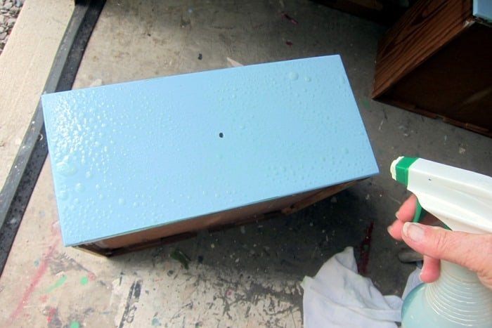 using household cleaner to wet distress furniture