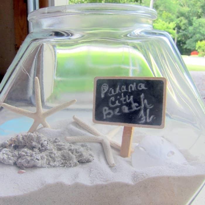 display sand and seashells in a vacation memory jar (9)