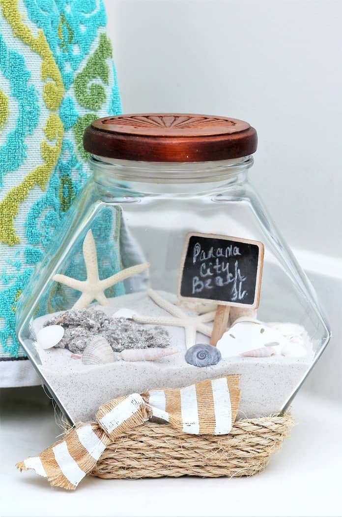 vacation memory jar includes beach sand and seashells along with sisal rope glued to jar
