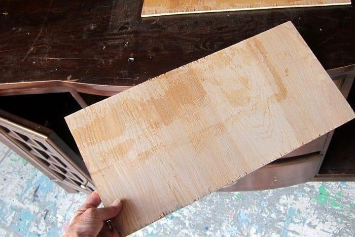 cut a piece of wood to repair furniture