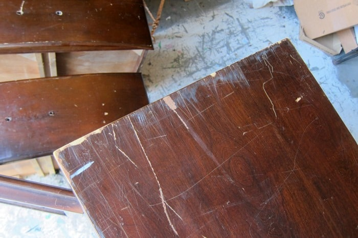 top of furniture with deep scratches in finish