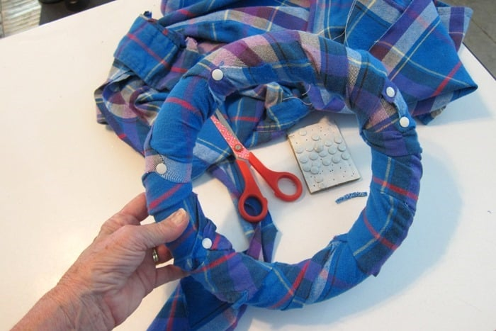 use small white tacks to adhere flannel fabric to wreath form