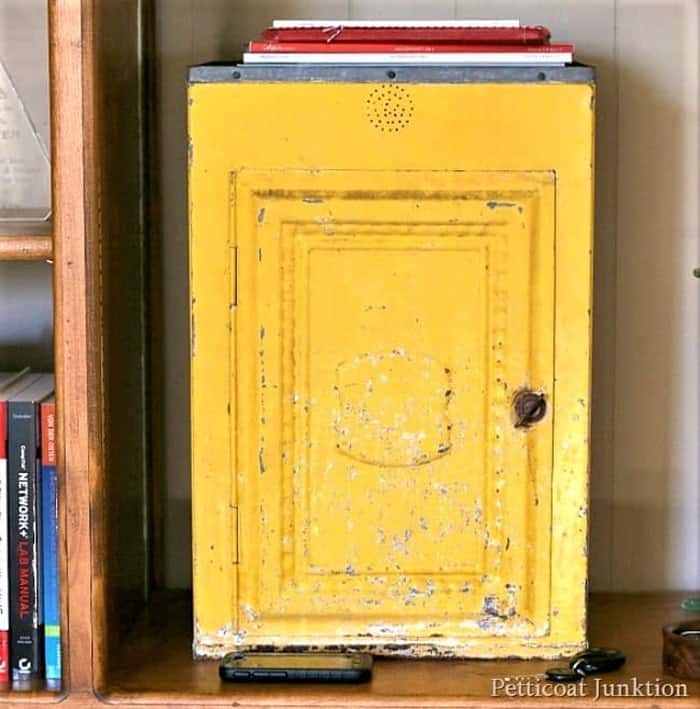 yellow tin cabinet